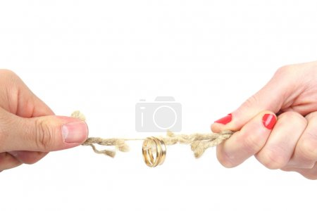 Photo for Tug of war between husband and wife - Royalty Free Image