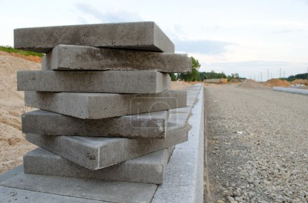 Pavement tiles on new sidewalk. New road works