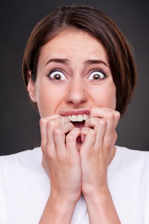 Photo for Studio picture of shocked and screaming woman over dark background - Royalty Free Image