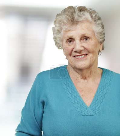 Portrait of senior woman smiling, indoor
