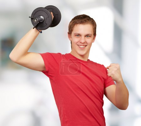 Photo for Young man doing fitness with weights indoor - Royalty Free Image