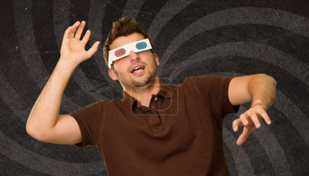 Man Watching Television In 3d Glasses