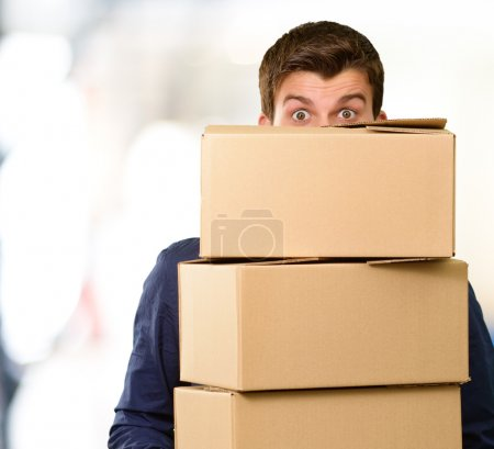 Photo for Man holding cardboard boxes, outdoor - Royalty Free Image