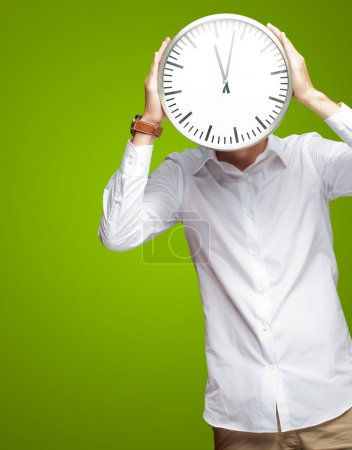 Young Man Holding Big Clock Covering His Face