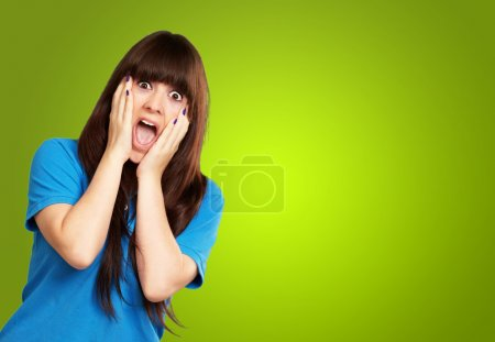 Photo for Young woman screaming isolated on green background - Royalty Free Image