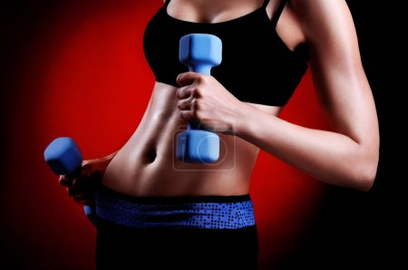 Closeup photo of a fitness model body