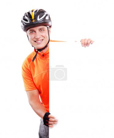 Smiling cyclist with blank board