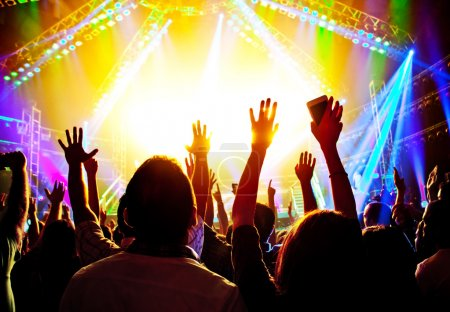 Photo for Rock concert, happy silhouettes, raise up hands, disco party with large group of dancing man, bright colorful stage lights, active lifestyle, music entertainment, nightclub, night life concept - Royalty Free Image