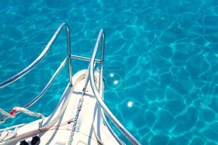 Balearic blue clean turquoise water from boat bow