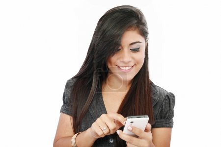 Portrait of a happy young business woman texting from her cellph