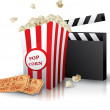 Popcorn and movie tickets with clapper board on wh...