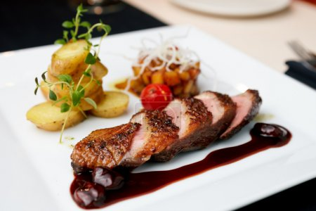 Photo for Roasted duck with pear,marinated in red wine and mascarpone rose - Royalty Free Image