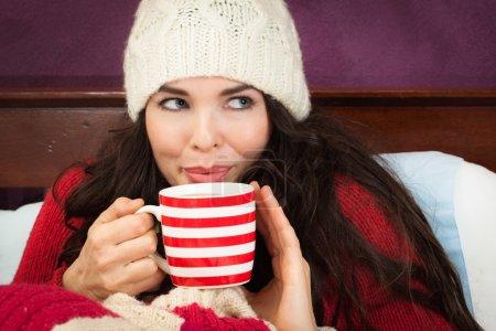 A beautiful young woman enjoying a hot frink under...