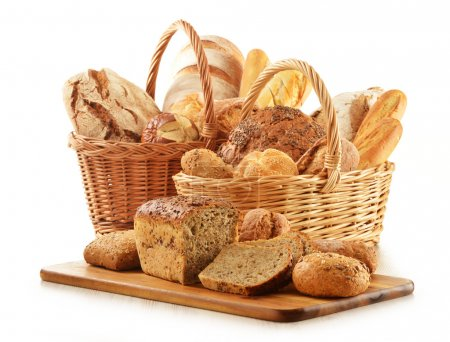 Composition with bread and rolls in wicker basket ...