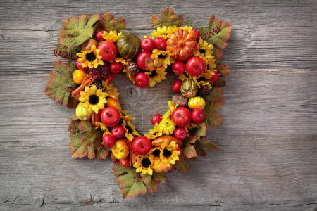 Photo for Autumn wreath over wooden background - Royalty Free Image