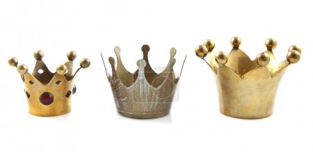 Three golden crowns in a row over white...