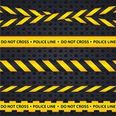 Policejní linii a nebezpečí pásky na tmavém pozadí