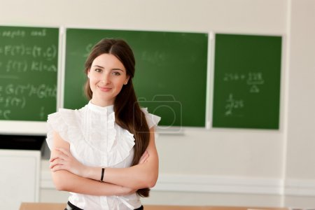 Teacher on background of blackboard