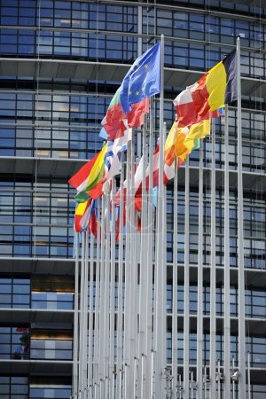 Photo for Flags in front of the European Parliament, Strasbourg, Alsace, France. Useful file for your article related to politics, foreign relations andd economic news. - Royalty Free Image