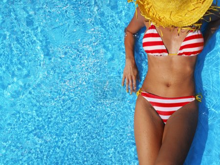 Photo for Woman relaxing in a pool - Royalty Free Image