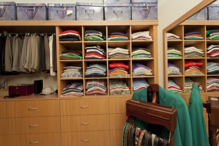 Photo for Male walk in wardrobe with shirts, pants, belts and drawers - Royalty Free Image