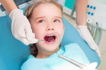 Photo for Girl opened her mouth to check with a dentist, monitor teeth health - Royalty Free Image