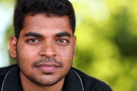 Photo of handsome middle-aged Indian/asian youth with content an
