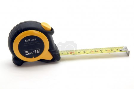 Isolated yellow measuring tape on white