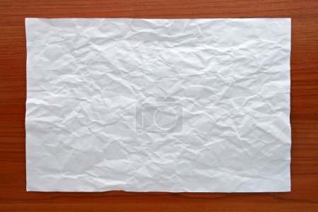 Wrinkled White paper attach on Wooden Board