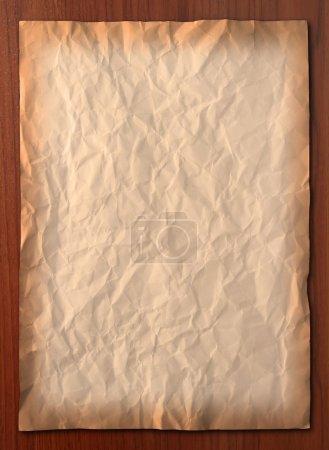 Photo pour Ridée papier vintage sur planche de bois, vertical - image libre de droit