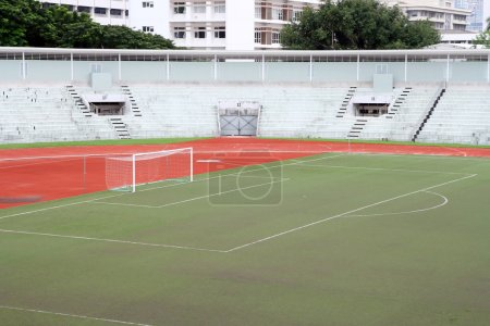 Soccer football goal with penalty area on fake grass pitch