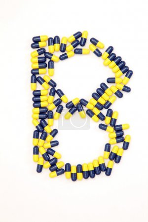 The letter B alphabet made of medical capsules