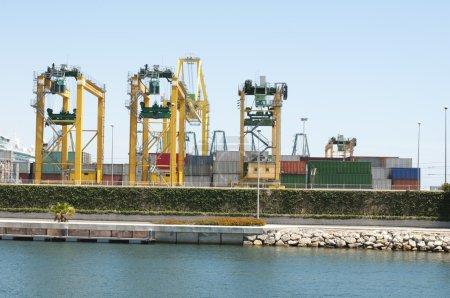 Working crane bridge in shipyard at dusk for Logis...