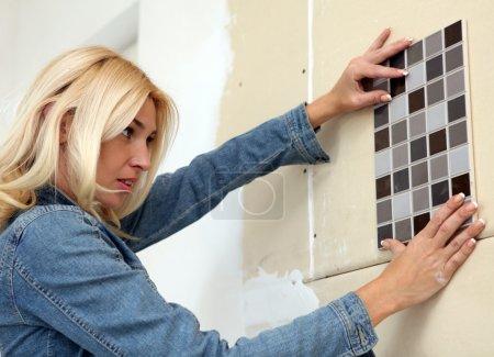 Young woman makes repairs