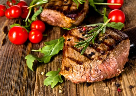 Photo for Grilled beef steaks on wood - Royalty Free Image