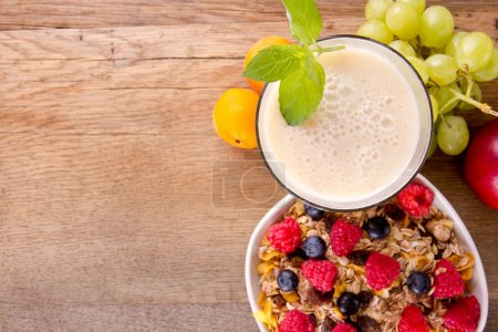 Photo for Healthy breakfast on wooden table, focused on drink. - Royalty Free Image