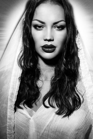 Fashion model portraits looks like Virgin Mary or Maria Magdalena