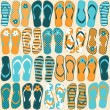 Seamless pattern with colorful flip flops....