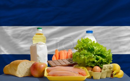 Basic food groceries in front of nicaragua national flag