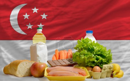 Basic food groceries in front of singapore national flag