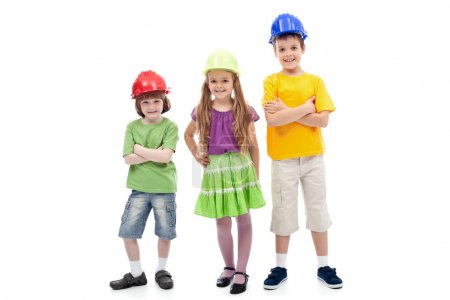 Photo for Kids with protective helmets posing - vocational guidance, isolated - Royalty Free Image