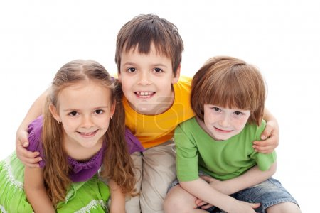 Photo for Childhood friends portrait - kids bracing each other, isolated - Royalty Free Image
