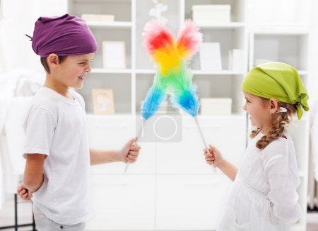 Photo for One for all and all for a tidy room - kids with duster brushes, focus on the girl - Royalty Free Image