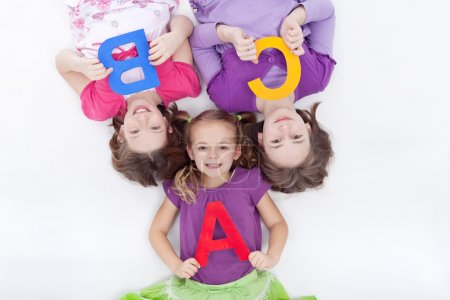 Girls holding A B C letters