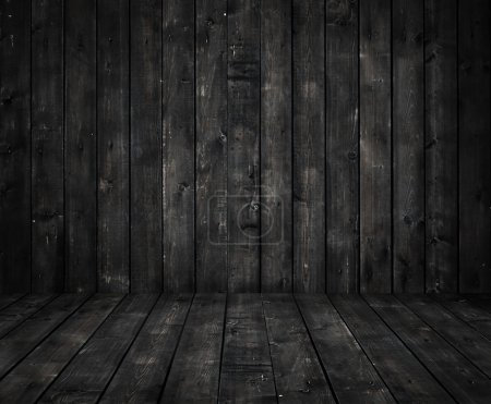 Black wall and wooden floor...