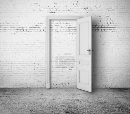 Photo for Open door in white brick room - Royalty Free Image