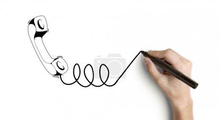 Photo pour Main combiné de dessin sur fond blanc - image libre de droit