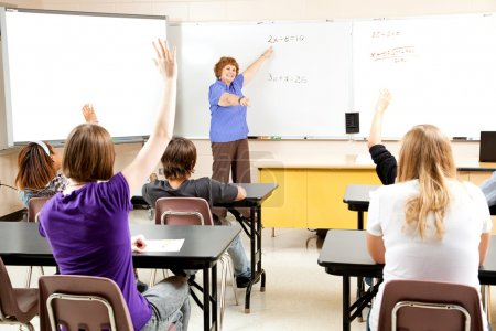 Photo for High school math teacher calls on students to solve a problem. - Royalty Free Image