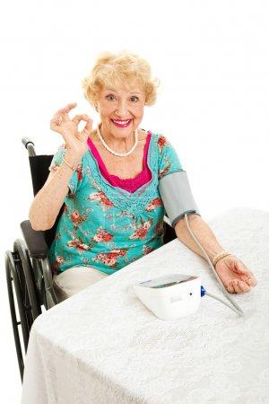 Disabled Senior Monitors Her Blood Pressure