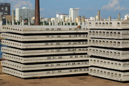 Photo for Pallets of new concrete blocks under sunlight against blue sky - Royalty Free Image